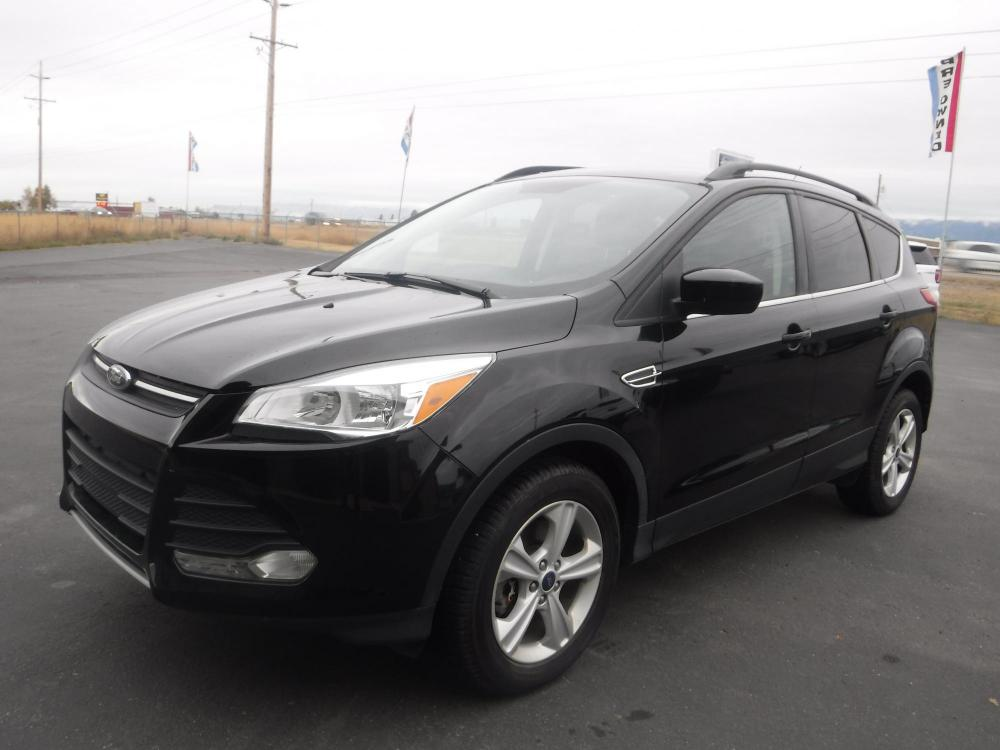 2016 Black Ford Escape SE 4WD (1FMCU9GX1GU) with an 1.6L L4 DOHC 16V engine, 6-Speed Automatic transmission, located at 3810 US Hwy 93 S, Kalispell, MT, 59901, (406) 752-1138, 48.131493, -114.269760 - Photo #0