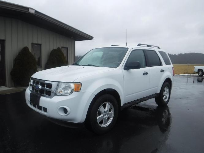 2011 White Ford Escape XLS 4WD AT (1FMCU9C78BK) with an 2.5L L4 DOHC 16V engine, 6-Speed Automatic transmission, located at 3810 US Hwy 93 S, Kalispell, MT, 59901, (406) 752-1138, 48.131493, -114.269760 - Photo #0